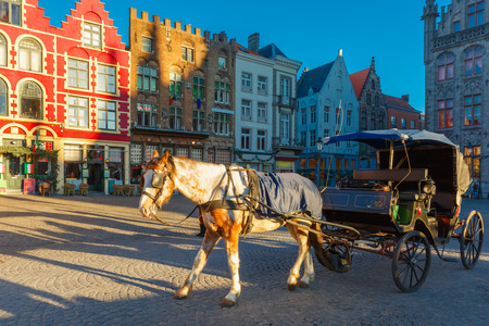 Horse carriage and tourists on the streets of Brugge Christmas,