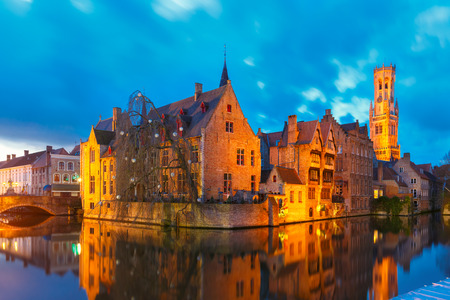 belfort: Cityscape with a tower Belfort from Rozenhoedkaai in Bruges at s