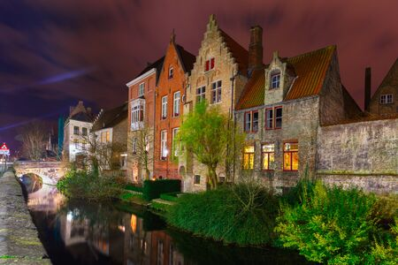 Cityscape with the picturesque night canal in Bruges photo