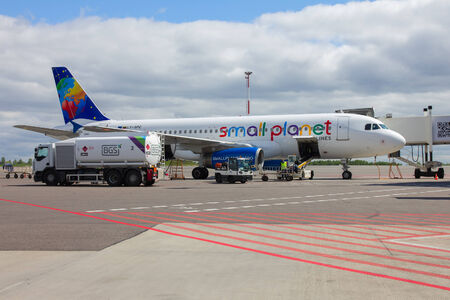 Vilnius, Lithuania - May 2, 2014: Preparation of aircraft Small Planet Airlines to fly, loading baggage, refueling at Vilnius airport