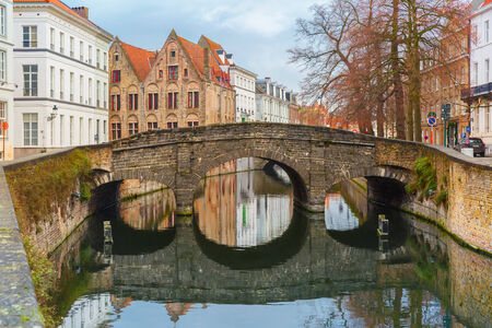 Scenic city view of Bruges canal and bridge photo