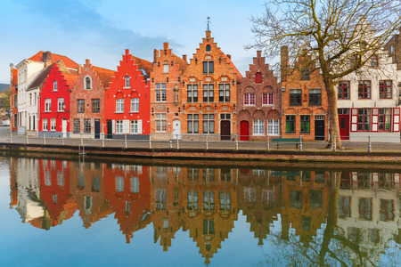 Scenic city view of Bruges canal with beautiful houses photo