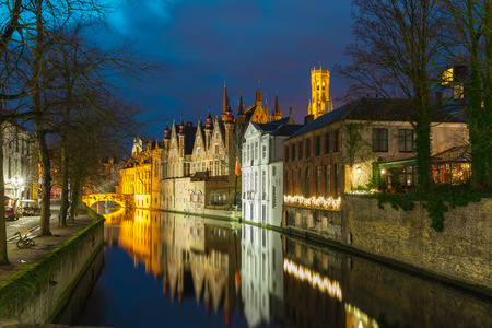 belfort: Night cityscape with a tower Belfort and the Green canal in Brug
