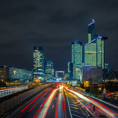 Night road with skyscrapers of La Defense, Paris, France. Stok Fotoğraf