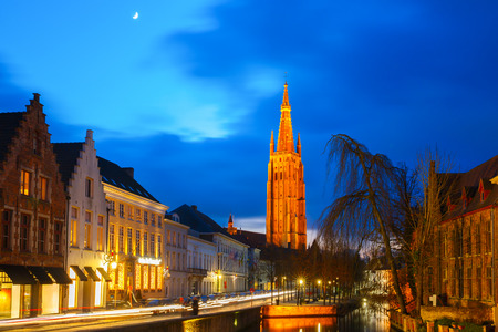 brugge: Cityscape with canal Dijver and a Church of Our Lady in Bruges Stock Photo