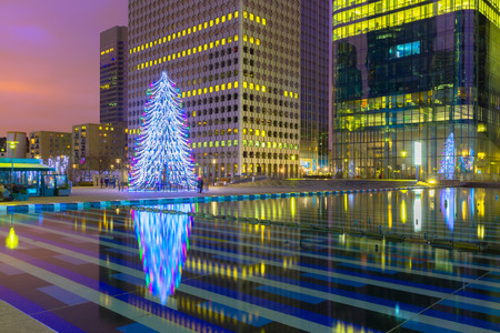 Christmas tree among the skyscrapers in Paris, France. photo