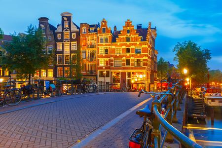 canal street: Night city view of Amsterdam canal and bridge Stock Photo