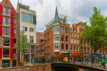canal street: Amsterdam canal and bridge with bikes, Holland, Netherlands