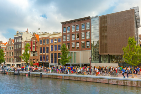 Amsterdam, Netherlands - Jule 29, 2014: Tourists queue at the Anne Frank House - the 3rd most visited museum in the Netherlands, after the Rijksmuseum and Van Gogh Museum.