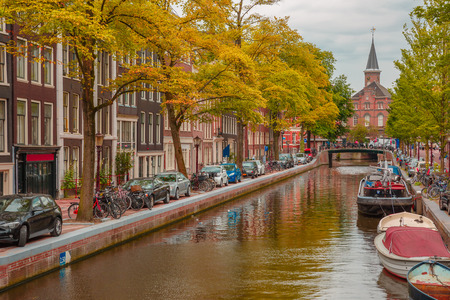 amsterdam canal: Amsterdam canal, church and typical houses, Holland, Netherlands.