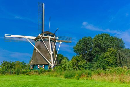 holland windmill: Windmill in Amsterdam, Holland, Netherlands Stock Photo
