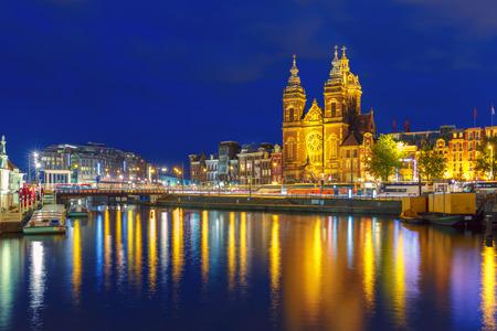 amsterdam: Night Amsterdam canal and Basilica Saint Nichola
