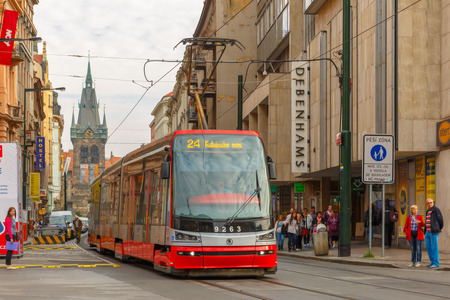 electric avenue: Prague, Czech republic - September 30, 2014: One of the symbol of Prague, red retro tram near Jindrisska Tower in Old Town.