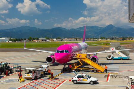 may fly: Bergamo, Italy - May 27, 2015: Preparation of aircraft Wizzair in airport Bergamo to fly. Wizzair is one of the largest low-cost European airline by scheduled passengers carried. Editorial