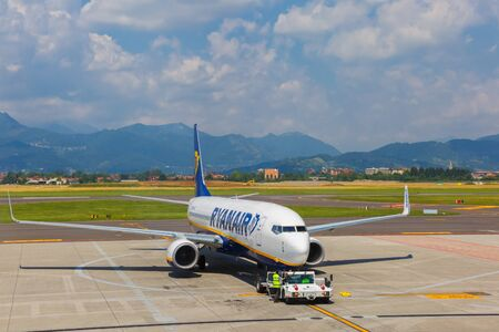 scheduled: Bergamo, Italy - May 27, 2015: Preparation of aircraft Ryanair in airport Bergamo to fly. Ryanair is one of the largest low-cost European airline by scheduled passengers carried. Editorial