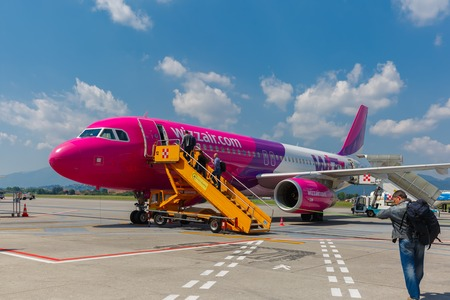 scheduled: Bergamo, Italy - May 27, 2015: People boarding a Wizzair on the route Bergamo-Vilnius. Wizzair is one of the largest low-cost European airline by scheduled passengers carried.