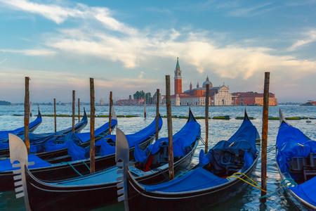 italia: Gondolas at twilight in Venice lagoon, Italia Stock Photo