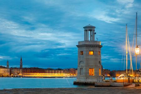 pharos: Ancient lighthouse on the island San Giorgio Maggiore  at night in Venice lagoon, Italia