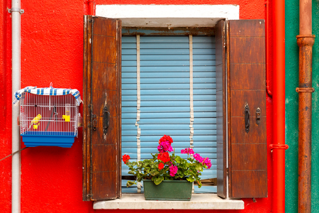 venetian blind: Colorful window on the wall, Burano, Venice, Italy Stock Photo