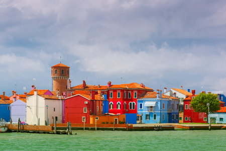 sea of houses: Colorful houses and tower on the famous island Burano, view from the sea, Venice, Italy