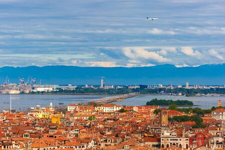 the mainland: View from Campanile di San Marco to bridge between the island and the mainland of Venice Mestre, the seaport and the mountains at summer morning in Venice, Italy Stock Photo