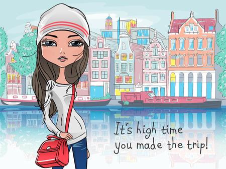 Modieuze hipster meisje toerist in een leren jas, jeans en rode laarzen op straat in Amsterdam met de traditionele Nederlandse huis
