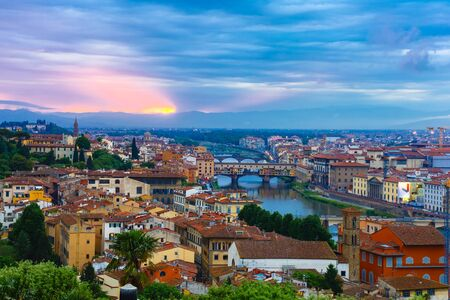 river arno: River Arno with bridge Ponte Vecchio at sunset from Piazzale Michelangelo in Florence, Tuscany, Italy Stock Photo