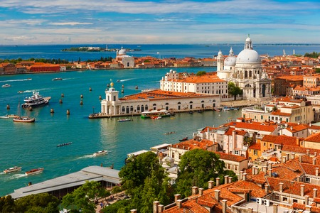 View from Campanile di San Marco to Grand Canal and Basilica di Santa Maria della Salute at summer morning in Venice, Italy
