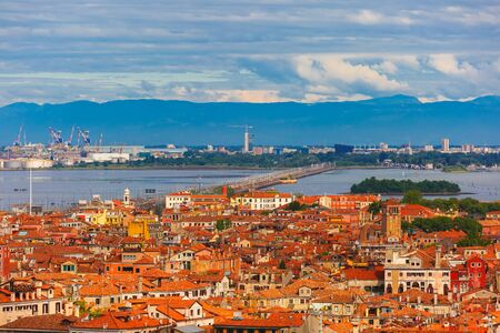 mainland: View from Campanile di San Marco to bridge between the island and the mainland of Venice Mestre, the seaport and the mountains at summer morning in Venice, Italy Stock Photo