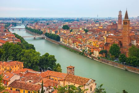 roman: Verona skyline with river Adige, Santa Anastasia Church and Torre dei Lamberti or Lamberti Tower at evening, view from Piazzale Castel San Pietro, Italy Stock Photo