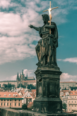 st charles: St John the Baptist statue on the Charles Bridge in Prague, Czech Republic. Toning in cool tones Stock Photo