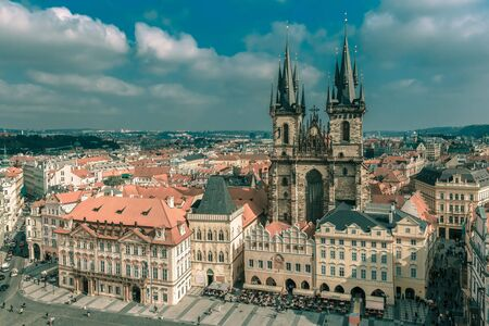 old town square: Aerial view over Church of Our Lady before Tyn at Old Town square in Prague, Czech Republic. Toning in cool tones Stock Photo
