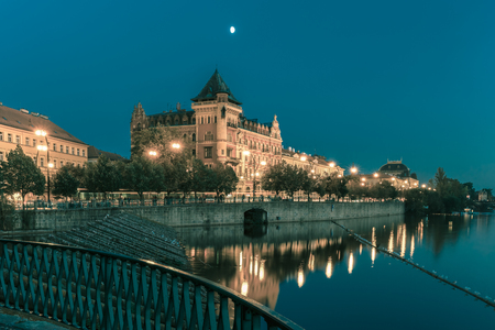 praga: Night cityscape with views of Smetanovo waterfront in Prague, Czech Republic. Toning in cool tones