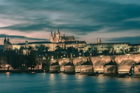 Prague Castle, Charles Bridge and the Little Quarter at sundown, Prague, Czech Republic. Toning in cool tones