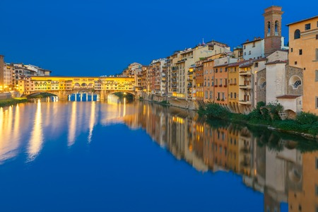 in europe: Old houses and tower on the embankment of the River Arno and Ponte Vecchio at night, Florence, Tuscany, Italy