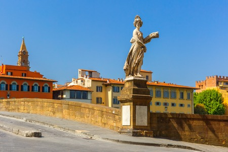 trinita: Statue on the bridge of Santa Trinita over the river Arno in Florence,  Tuscany, Italy Stock Photo