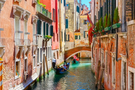 voyage: Picturesque view of Gondolas on lateral narrow Canal, Venice, Italy.