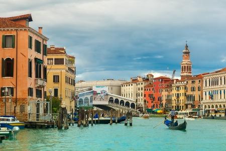 rialto: Grand Canal near bridge Ponte di Rialto in summer day, Venice, Italy. Stock Photo