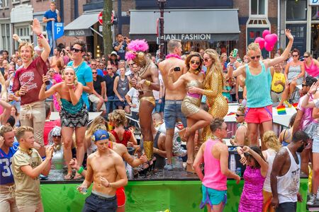 roze: Amsterdam, Netherlands - August 2, 2014: Participants at the famous Canal Parade of the Amsterdam Gay Pride 2014. Every year the parade is visited by more than 400000 people. Editorial