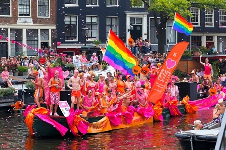 gay parade: Amsterdam, Netherlands - August 2, 2014: Participants at the famous Canal Parade of the Amsterdam Gay Pride 2014. Every year the parade is visited by more than 400000 people. Editorial