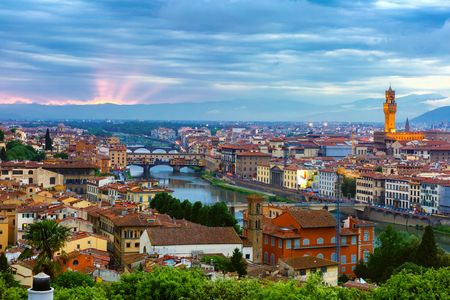 river view: River Arno with bridge Ponte Vecchio and Palazzo Vecchio at sunset from Piazzale Michelangelo in Florence, Tuscany, Italy Stock Photo
