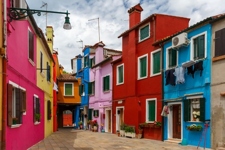 Island Living: Patio With Colorful Houses On The Famous Island Burano,  Venice, Italy
