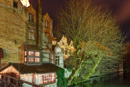 bruges: Scenic cityscape with the picturesque night canal in Bruges, Belgium Stock Photo