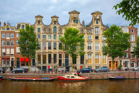 holland: City view of Amsterdam canals and typical houses, boats and bicycles, Holland, Netherlands. Stock Photo
