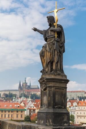 st charles: St. John the Baptist statue on the Charles Bridge in Prague (Czech Republic) Stock Photo