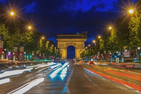 Arc de Triomphe: Arc de triomphe Paris (Arch of Triumph and Champs Elysees) at sunset