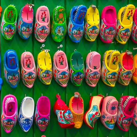 holland: Amsterdam, Netherlands - July 30,2014: Dutch souvenirs clogs - box for shoe brush on the counter in the Souvenir shop in Amsterdam. Wooden shoes clogs, windmills and tulips - the most popular souvenirs and traditional symbol of Holland. Editorial