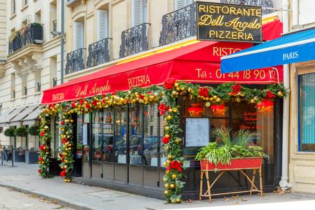 Paris, France - December 21, 2015: Trattoria Dell Angelo, an Italian restaurant near the Eiffel Tower, in a Christmas decoration Publikacyjne