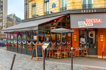 odessa: Paris, France - December 22, 2015: Cafe Odessa in the Montparnasse Quarter near the Gare Montparnasse, Montparnasse Tower and Galeries Lafayette Editorial