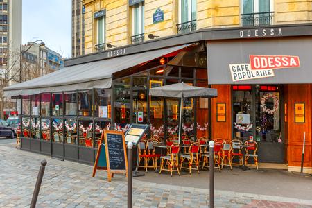 Paris, France - December 22, 2015: Cafe Odessa in the Montparnasse Quarter near the Gare Montparnasse, Montparnasse Tower and Galeries Lafayette Editöryel